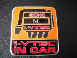 Emblem ivtec in car - yellow 6x5,5cm