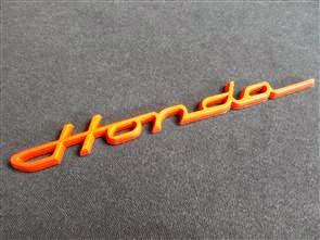 Emblem tulisan honda merah